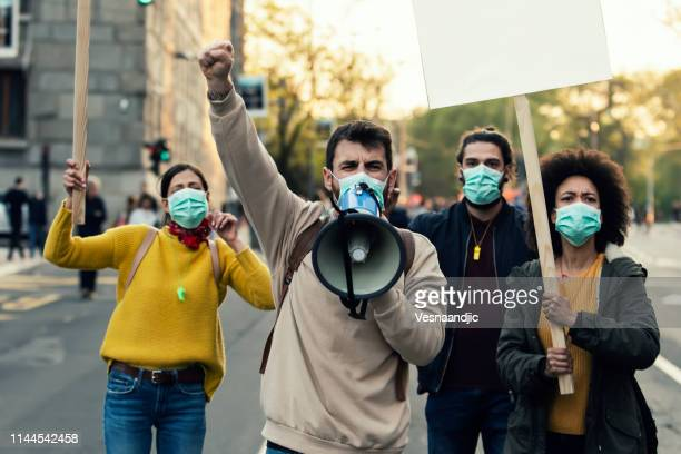 young protesters - protestor mask stock pictures, royalty-free photos & images