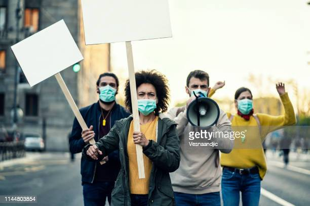 young protesters - protestor stock pictures, royalty-free photos & images