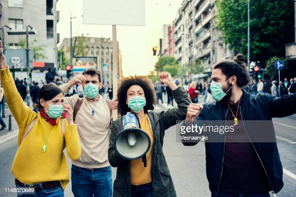 young protesters - democracy stock pictures, royalty-free photos & images
