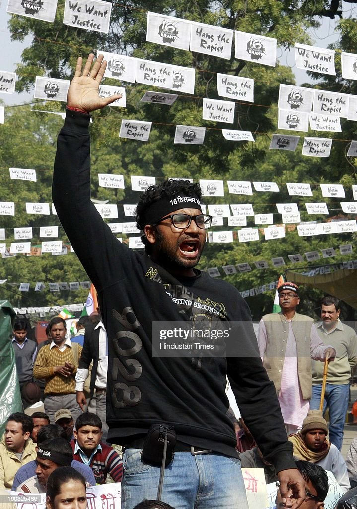 A young protestor shout slogans demanding the death penalty for six men accused of the fatal gang rape of a young woman last month during protest at Jantar Mantar on January 29, 2013 in New Delhi, India.