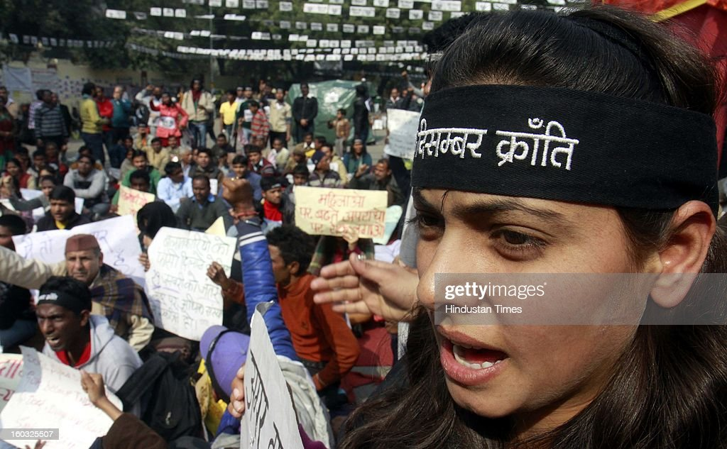 A young protestor wearing headband shout slogans demanding the death penalty for six men accused of the fatal gang rape of a young woman last month during protest at Jantar Mantar on January 29, 2013 in New Delhi, India.