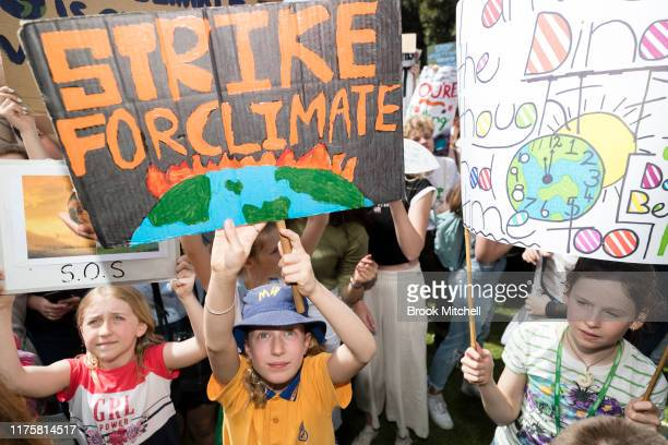 Young protestors hold up signs during Climate Strike at the Domain on September 20, 2019 in Sydney, Australia Australia. Rallies held across...