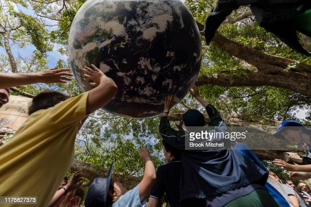 Young protestors play with a large globe on September 20 2019 in Sydney Australia Rallies held across Australia are part of a global mass day of...