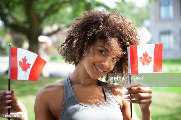 young proud canadian woman - canada day stock pictures, royalty-free photos & images