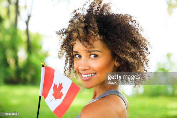 young proud canadian woman - canadian culture stock pictures, royalty-free photos & images