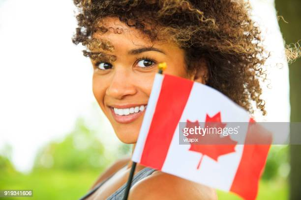 young proud canadian woman - canadian flag stock pictures, royalty-free photos & images