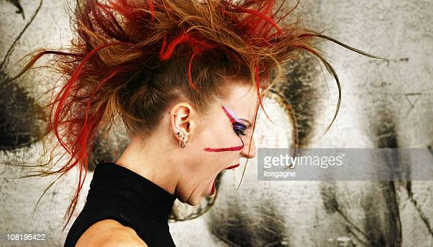 young punk woman yelling - mohawk stock photos and pictures