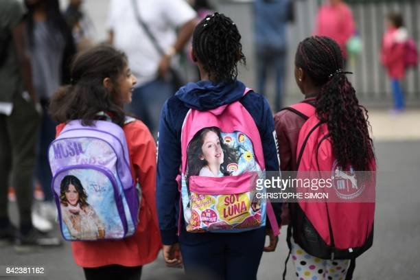 Young pupils arrive at their primary school at the start of the new school year on September 4 in CorbeilEssonnes outside Paris / AFP PHOTO /...