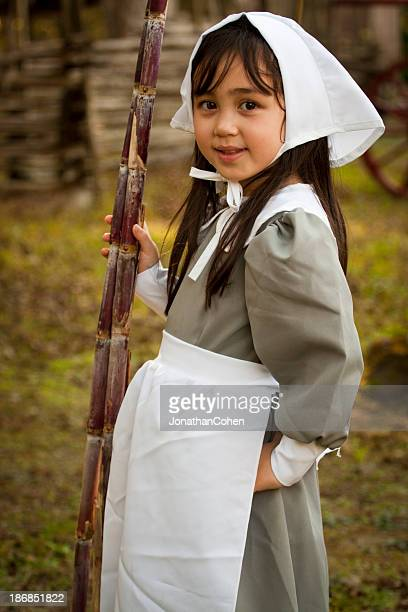 young puritan with sugar cane - pilgrims stock photos and pictures
