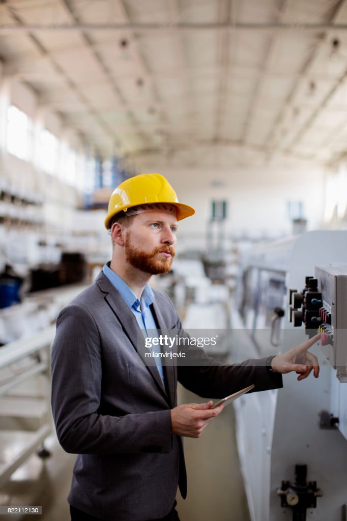 Young quality controller in the factory : Stock Photo