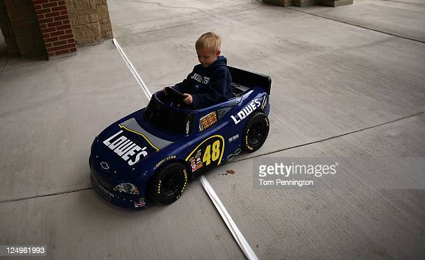 A young race can drives his toy car to meet fivetime NASCAR Sprint Cup Series champion Jimmie Johnson during a Texas footballstyle pep rally at Byron...