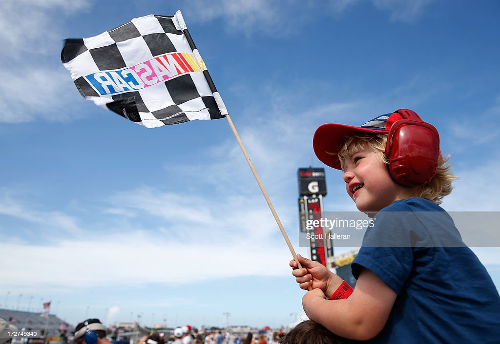 A young race fan enjoys the action during practice for the NASCAR Sprint Cup Series Coke Zero 400 at Daytona International Speedway on July 4, 2013 in Daytona Beach, Florida.