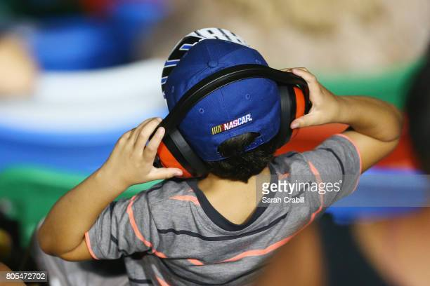 A young race fan looks on during the Monster Energy NASCAR Cup Series 59th Annual Coke Zero 400 Powered By CocaCola at Daytona International Speedway...