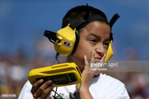 A young race fan looks on during the Monster Energy NASCAR Cup Series Apache Warrior 400 presented by Lucas Oil at Dover International Speedway on...