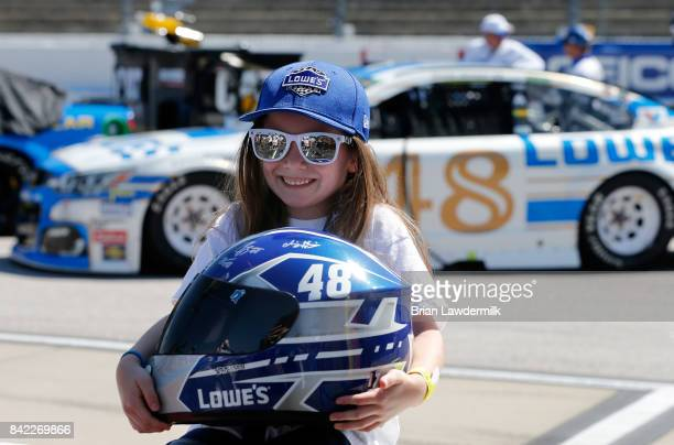 A young race fan poses for a photo on pit road prior to the Monster Energy NASCAR Cup Series Bojangles' Southern 500 at Darlington Raceway on...