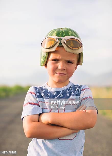 Young Racing Boy in Watermelon Helmet