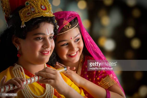 young radha and krishna smiling - radha krishna stock pictures, royalty-free photos & images