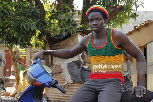 A young rasta on motorcycle