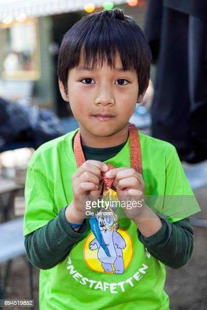 Young Ray Ray whole lives Oesterbro in Copenhagen shows proudly his medal which he received by Crown Princess Mary for finishing the 'Children's...