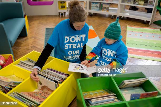 Young reader and his mum in the reopened Carnegie Library on Herne Hill in south London which has opened its doors for the first time in almost 2...