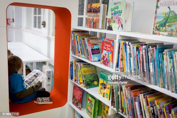 A young reader in the reopened Carnegie Library on Herne Hill in south London which has opened its doors for the first time in almost 2 years on 15th...