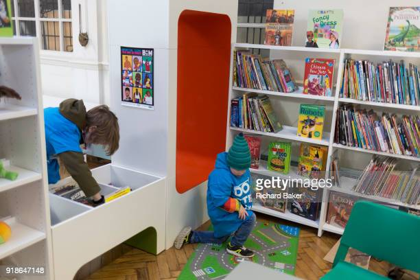 Young readers in the reopened Carnegie Library on Herne Hill in south London which has opened its doors for the first time in almost 2 years on 15th...