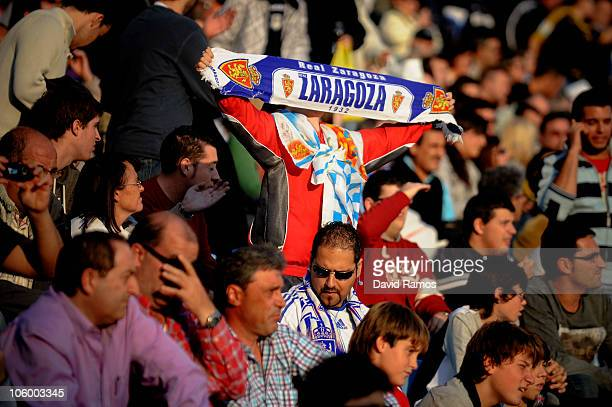 Young Real Zaragoza fan holds up a Real Zargoza's scarf during the La Liga match between Real Zaragoza and Barcelona at La Romareda on October 23,...