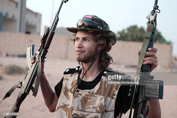 A young rebel fighter prepares to enter the nomans land for a raid beyond the last rebel outpost on July 20 2011 in the western Jebel Nafusa moutains...