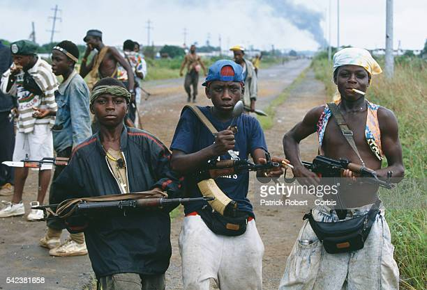 Young rebel fighters pose with their assault rifles in Monrovia during the Liberian Civil War In 1989 Charles Taylor leader of the NPFL launched a...