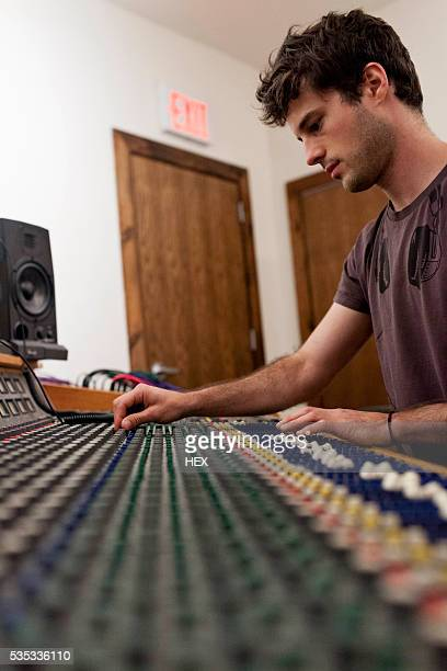 Young recording engineer at work