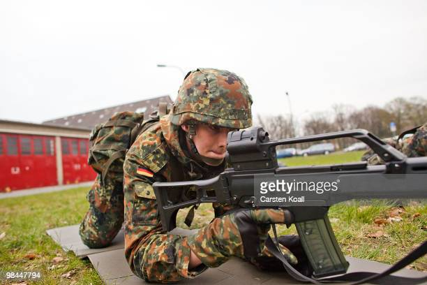 A young recruit of the Bundeswehr guard of honour practices in basic training with the G36 assault rifle at the Julius Leber barracks on April 14...