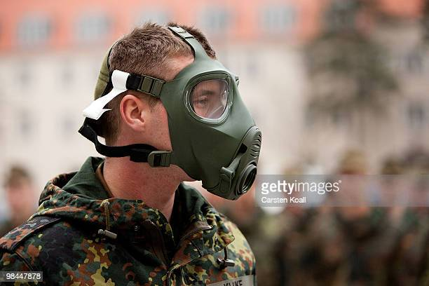 A young recruit of the Bundeswehr guard of honour tries a abcprotection mask on at the Julius Leber barracks on April 14 2010 in Berlin Germany...