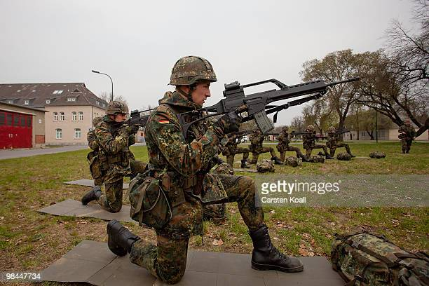 Young recruits of the Bundeswehr guard of honour practice in basic training with the G36 assault rifle at the Julius Leber barracks on April 14 2010...