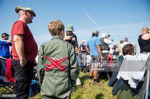 Young Red Arrows fan during the Royal International Air Tattoo at RAF Fairford on July 12, 2014 in Fairford, England. The Royal International Air...