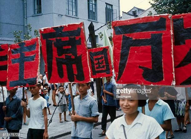 Young Red Guard members carry signs during a demonstration in Wushi China | Location Wushi China