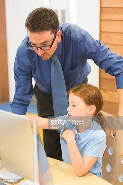 Young Red Haired Girl With Teacher and Computer