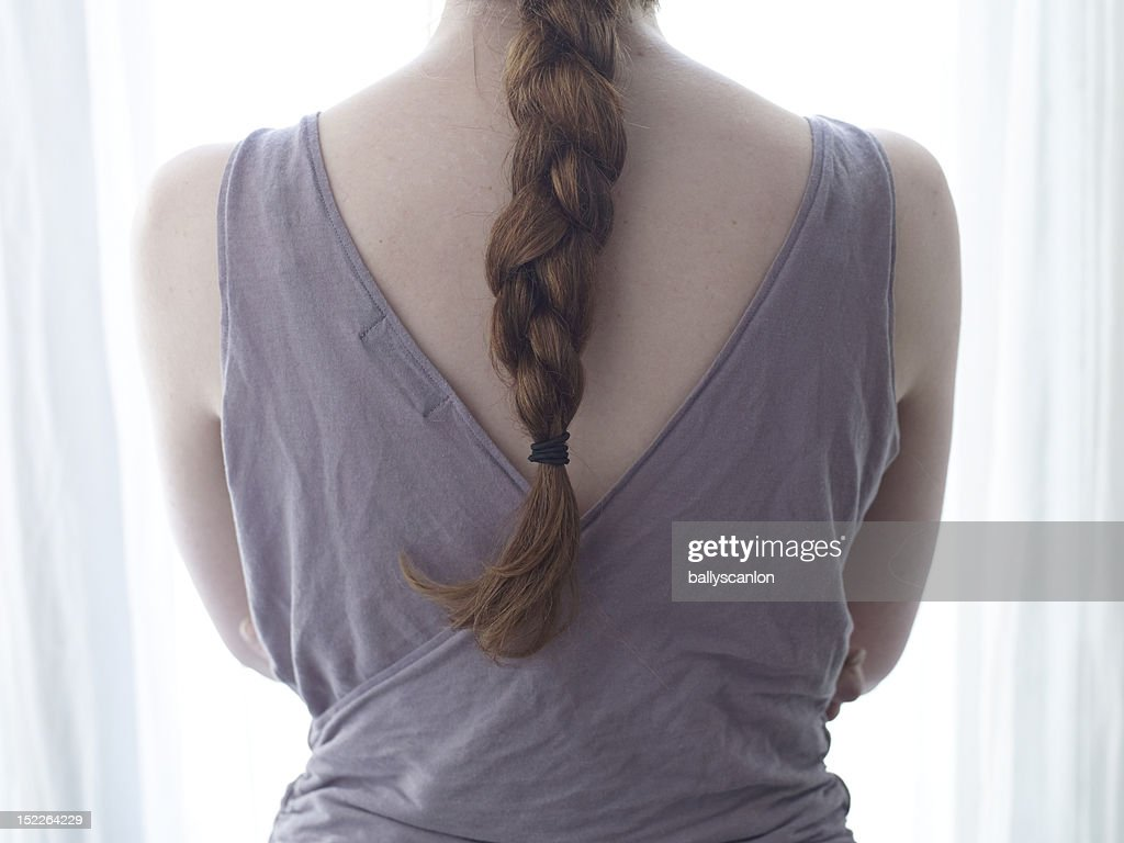 Young Red Haired Woman With Back To Camera. : Foto de stock