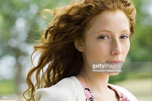Young red-haired woman outdoors, portrait