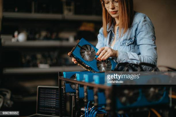 young redhead building a miner - cryptocurrency mining stock pictures, royalty-free photos & images
