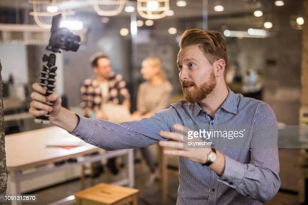 young redhead businessman vlogging at casual office. - influencer stock pictures, royalty-free photos & images