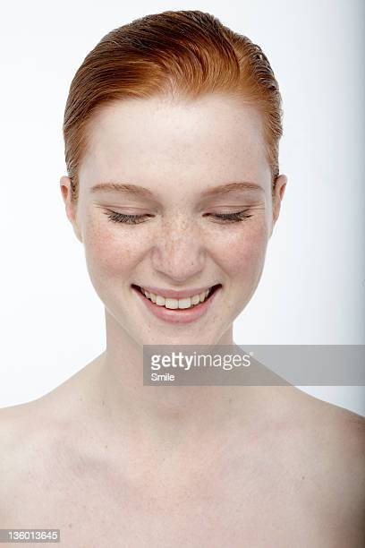 Young redhead laughing
