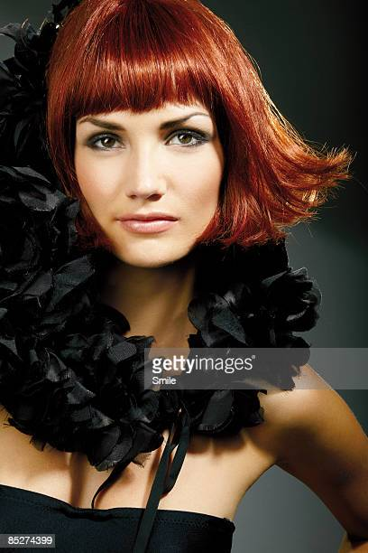 young redhead woman in evening gown, portrait