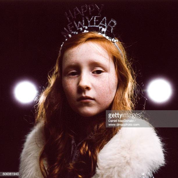 Young redheaded girl in festive costume to celebrate New Years
