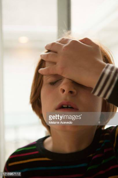 young redheaded girl short hair brown eyes and freckles close up hand on head closed eyes frustrated - frustration stock pictures, royalty-free photos & images