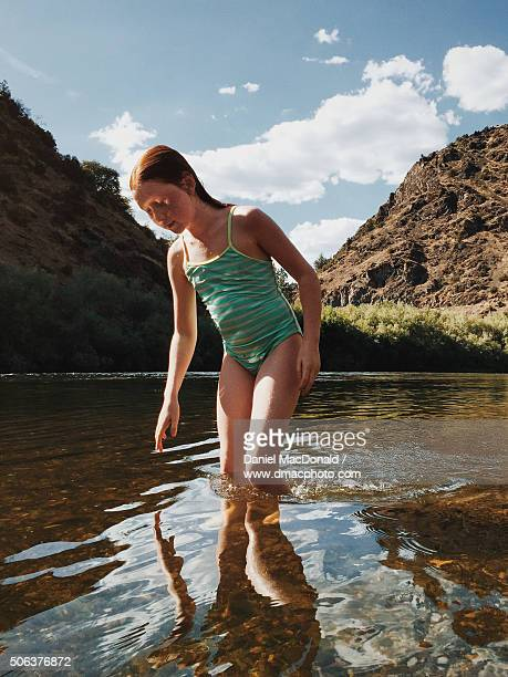 young redheaded girl wading in scenic klamath river on hot summer day - tween girls hot stock photos and pictures