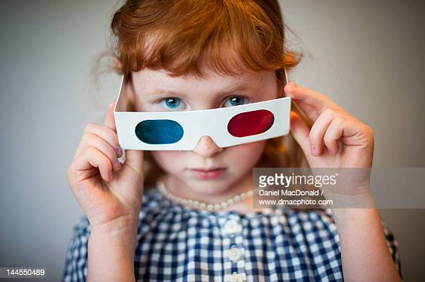 Young redheaded girl with 3D glasses