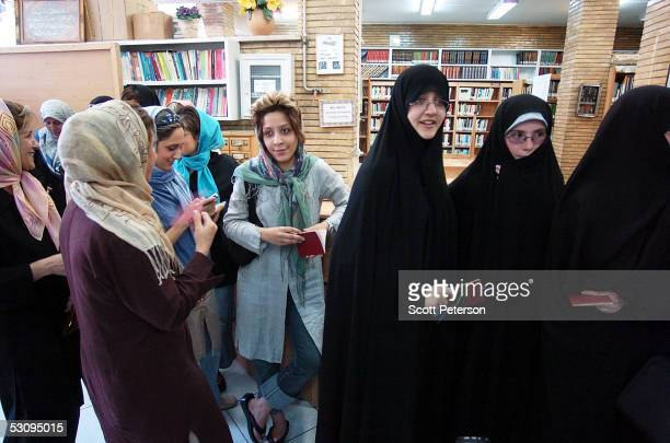 Young reformist and conservative Iranian women stand in the same line to vote on June 17 2005 in Tehran Iran Disillusioned with eight years of...