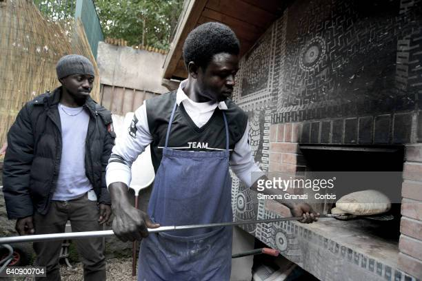 A young refugee cooking at the presentation of Meal Suspended at Casetta Rossa in Garbatellaon February 2 2017 in Rome Italy The initiative promotes...
