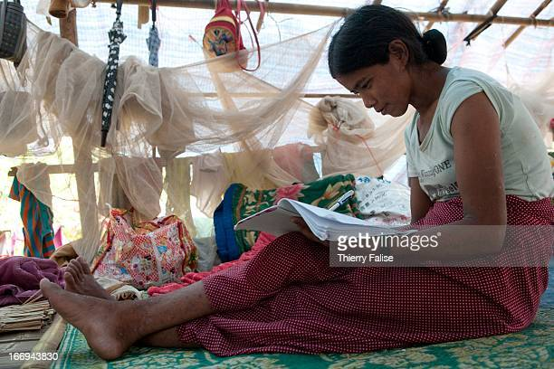 A young refugee writes poems in a makeshift camp set in a rural area south of Laiza Fighting has resumed in June 2011 between the Burmese army and...