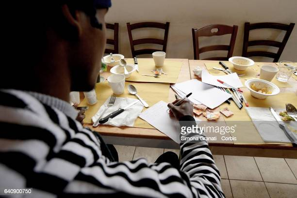 Young refugees eating at the presentation of Meal Suspended at Casetta Rossa in Garbatellaon February 2 2017 in Rome Italy The initiative promotes...
